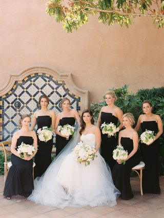 bridesmaids-in-black-dresses-by-jill-stuart-strapless-necklines-bride-in-white-neutral-bouquets