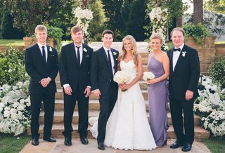 young-newlyweds-pose-with-brothers-and-mother-of-the-bride