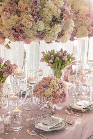 wedding-reception-inspiration-lavender-linen-floating-candles-silver-candle-votives-white-purple