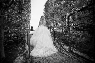 black-and-white-photo-of-bride-in-vera-wang-ball-gown-approaching-groom-for-first-look
