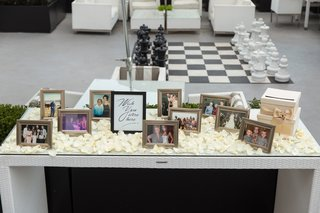 wedding-ceremony-memorial-table-with-photos-and-ivory-rose-petals