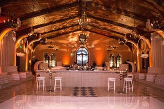 wedding-after-party-with-white-decor-white-dance-floor-bar-stools-tufted-ottoman-bench-furniture