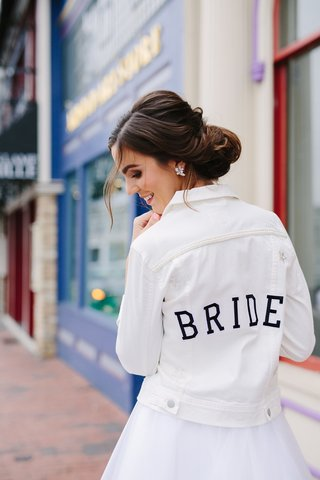 white-denim-jacket-with-bride-on-the-back-trendy-bridal-accessories-bride-jacket