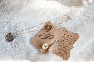 brides-handwritten-note-to-groom-on-die-cut-paper-with-unique-gold-cuff-links
