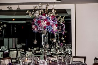 tall-centerpiece-with-blue-and-white-hydrangeas-burgundy-roses-taller-white-flowers