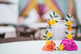 mehndi-in-orange-county-frosted-glass-with-romantic-quote-with-gold-trim-and-bright-flowers