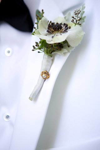 grooms-boutonniere-white-greenery-flower-foliage-gem-pin-white-jacket