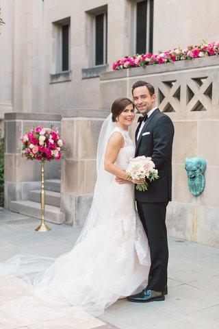 bride-in-monique-lhuillier-sleeveless-mermaid-wedding-dress-groom-in-michael-kors-tuxedo