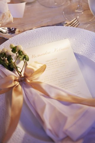 white-charger-plate-with-menu-letterpress-white-napkin-gold-ribbon-white-privet-berries