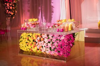wedding-reception-yellow-orange-pink-flowers-in-lucite-table-multicolored-wedding-reception-decor