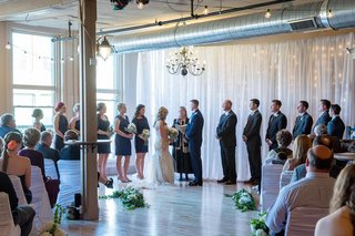 bride-and-groom-at-altar-under-exposed-ceiling