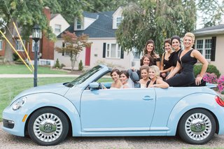 bride-and-bridesmaids-riding-in-light-blue-vw-beetle-convertible