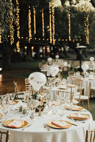 saddlerock-ranch-wedding-reception-with-centerpieces-made-with-paper-lantern-hot-air-balloons