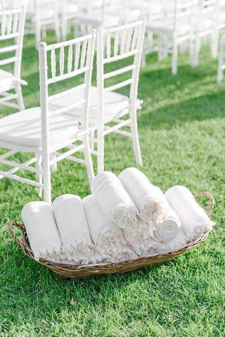 wedding-ceremony-green-grass-lawn-white-chairs-blankets-fleece-in-basket-wedding-ideas