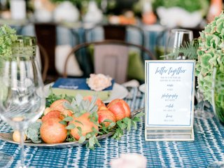 bridal-shower-decor-gold-platter-of-plums-and-cherries-succulents-greenery-blue-white-linens