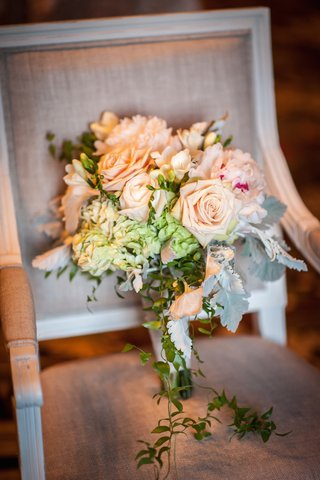 brides-bouquet-of-green-hydrangeas-peach-roses-white-peonies-with-magenta-centers-dusty-miller