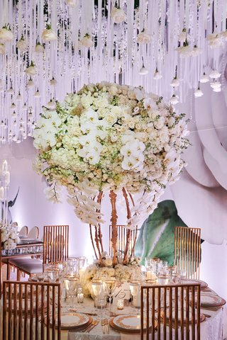 wedding-reception-flower-print-wallpaper-hanging-rose-crystal-ribbon-white-centerpiece-gold-chairs