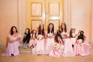 one-ring-bearer-and-flower-girls-junior-bridesmaids-in-pink-dresses-with-bouquets-and-flower-crowns