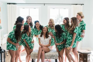 bride-in-white-pajama-short-set-bridesmaids-in-pajama-short-set-with-tropical-leaves