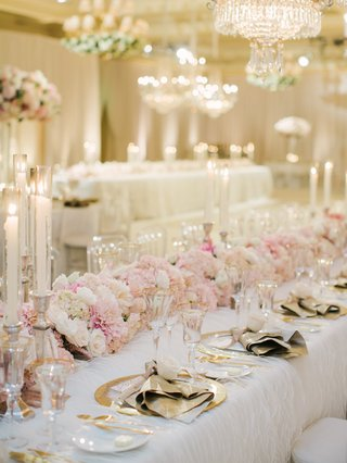 wedding-reception-table-with-floral-runner-of-pink-white-roses-hydrangeas-dahlias