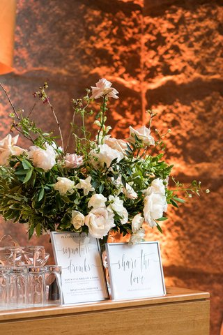 white-flowers-peony-rose-signature-drinks-share-the-love-hashtag-in-frame-on-wood-bar