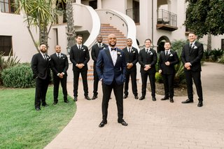 groom-shane-vereen-nfl-player-in-navy-tuxedo-with-groomsmen-black-white-suits-boutonniere