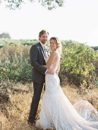 bride-groom-winery-setting-sonoma-california-wedding-berta-gown-suit-vineyard-rustic