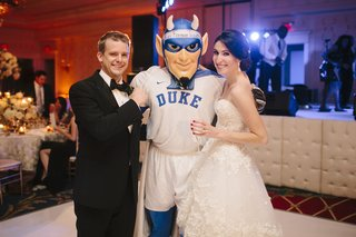 bride-and-groom-with-duke-devils-mascot-at-reception