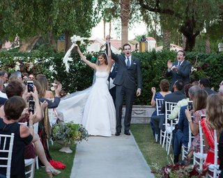 outdoor-wedding-ceremony-at-la-quinta-resort-club-palm-springs-area-a-line-gown-guests-taking-pics