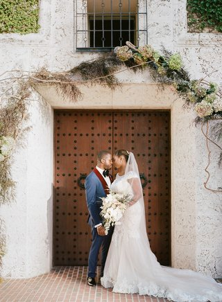the-bath-club-miami-wedding-groom-in-blue-suit-with-burgundy-lapels-wedding-dress-lace-cap-sleeves