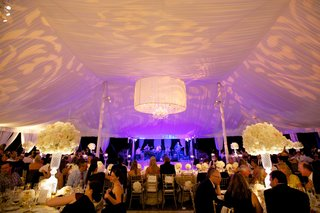 tent-wedding-dinner-service-with-violet-lighting