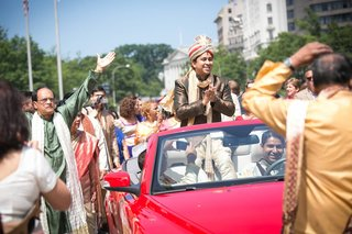 indian-groom-rides-in-red-convertible-during-the-baraat