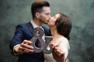 cute-bride-and-groom-kissing-portrait