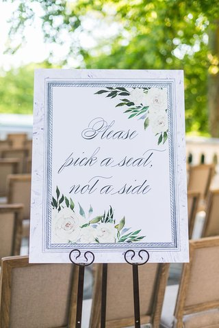 wedding-ceremony-please-pick-a-seat-not-a-side-ivory-flower-watercolor-motif-on-easel-display