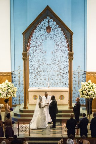 african-american-bride-and-groom-at-altar-with-pastor