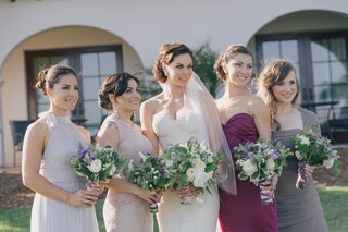 bridesmaid-dresses-in-differing-styles-and-colors