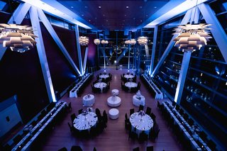 clinton-library-wedding-venue-reception-purple-lighting-modern-fixtures-white-tablecloths