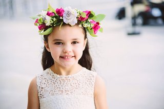 flower-girl-in-white-flower-girl-dress-with-flower-crown-lavender-pink-white-flowers-and-green-leave