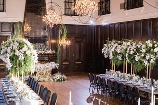 ebell-long-beach-wedding-long-tables-with-tall-centerpieces-with-greenery-and-white-orchids