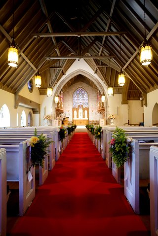 red-carpet-runner-between-pews-at-church-wedding-ceremony-in-illinois-stained-glass