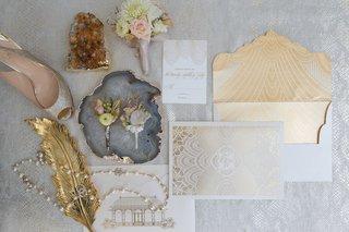 ceci-new-york-golden-wedding-invitation-suite-louboutin-heel-vintage-chanel-pearl-necklace