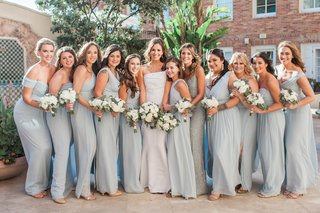 bride-in-j-mendel-wedding-dress-bridesmaids-in-misty-blue-dessy-and-adrianna-papell-dresses