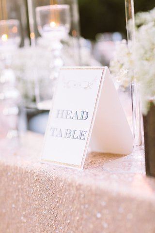 outdoor-wedding-head-table-with-sign-golden-or-blush-sequined-tablecloth