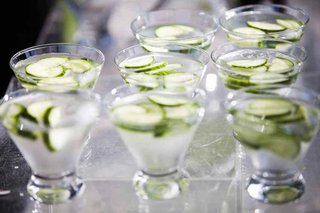 glass-cups-with-slices-of-cucumber-floating-on-water