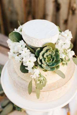cheese-wheel-wedding-cake-with-succulent-decorations