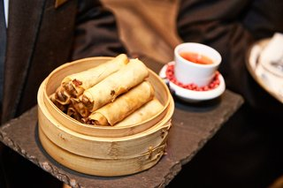 spring-rolls-served-at-cocktail-hour-in-traditional-wood-bowl