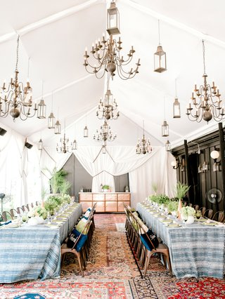bridal-shower-at-nomad-hotel-rooftop-new-york-summer-low-centerpiece-two-long-tables-industrial