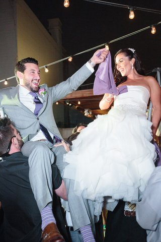 bride-in-a-fit-and-flare-vera-wang-dress-ruffled-skirt-and-groom-in-grey-suit-purple-tie-socks