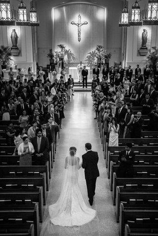 religious-wedding-ceremony-father-escorts-bride-down-aisle