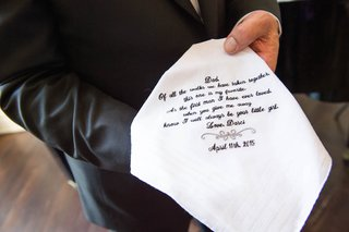 father-of-bride-holding-sentimental-handkerchief-with-embroidered-letter